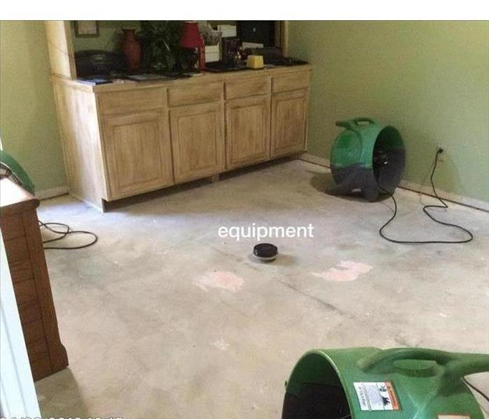 Airmovers equipment placed on kitchen floor